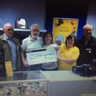 Nigel and I presenting a cheque to the staff at Marie Curie, Bridgend.