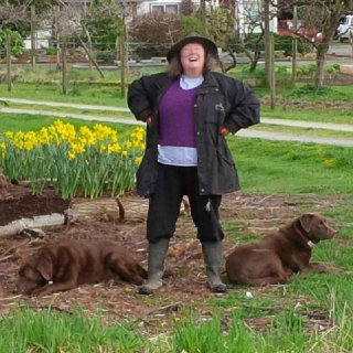 The author, gardening, with helpers.jpg