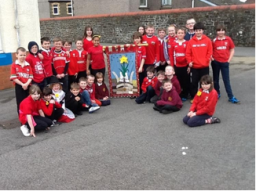 Ysgol Cwmgors (Cwmgors School) students with their 2014 Saint David's Day banner