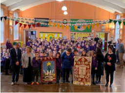 Ysgol Cwmgors (Cwmgors School) staff and students with their Saint David's Day banner