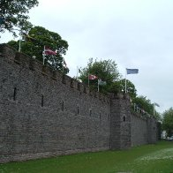 cardiff castle, canadian flag flying next to welsh flag