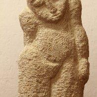 standing woman stone