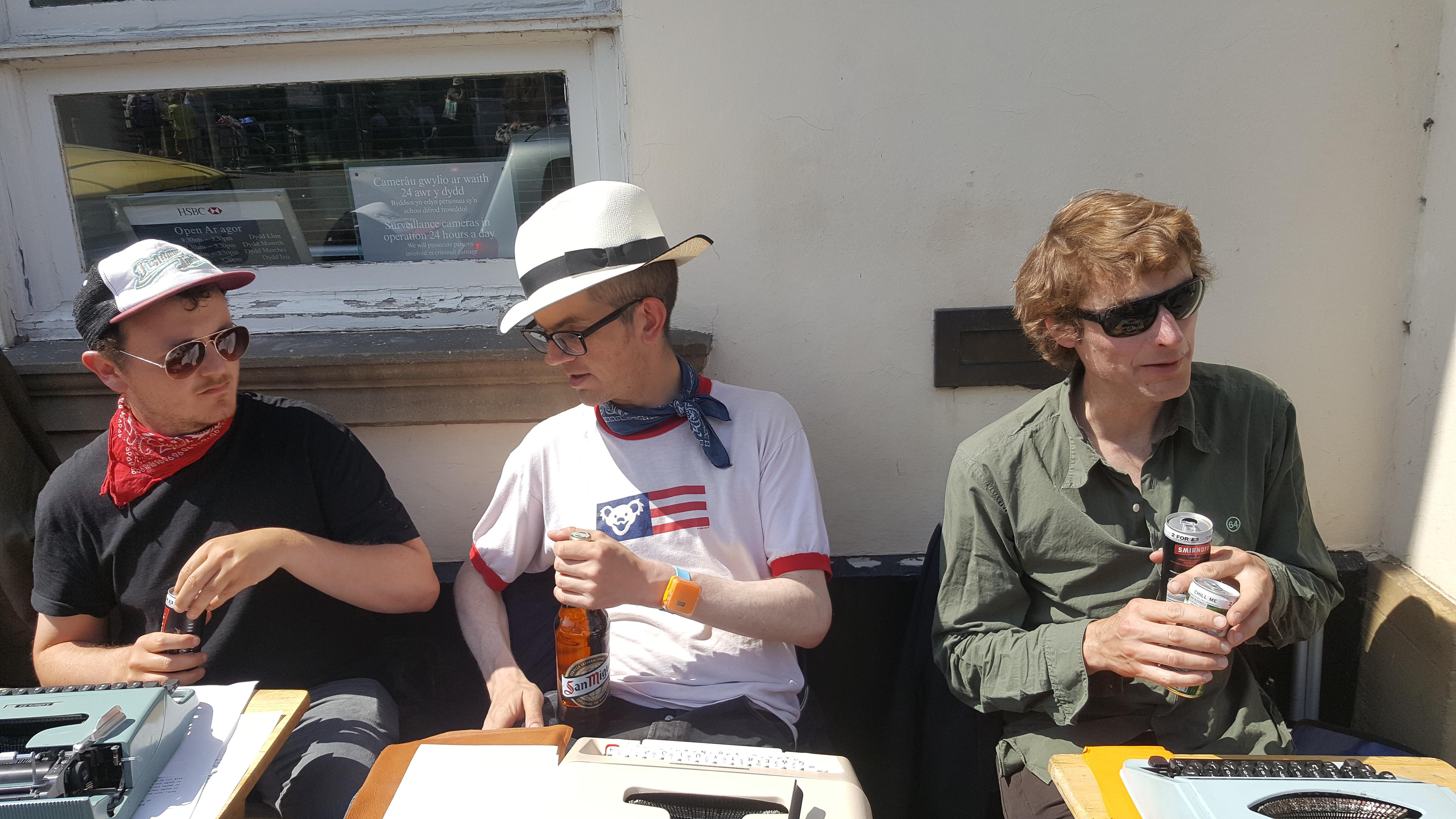 three sidewalk poets at Hay-on-Wye